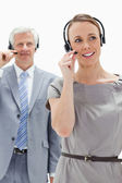 Close-up of a woman wearing a headset with a white hair business — Stock Photo