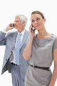 Close-up of a woman making a call with a white hair businessman — Stock Photo