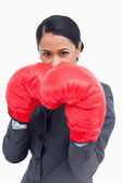 Close up of belligerent saleswoman with boxing gloves — Stock Photo