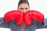 Aggressive tradeswoman with boxing gloves — Stock Photo