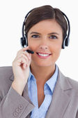 Female call center agent with headset — Stock Photo