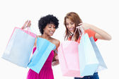 Teenage girls looking at each others purchases — Stock Photo