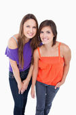 Two teenage girls leaning forward — Stock Photo