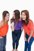 Teenagers laughing while singing karaoke — Stock Photo