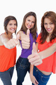 Three teenage girls proudly showing their happiness by putting t — Stock Photo
