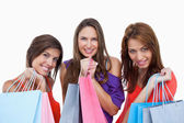 Teenage girls proudly coming back from shopping — Stock Photo