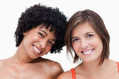 Teenage girls smiling and posing against a white background — Stock Photo