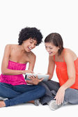 Teenage girl showing a funny application on her tablet PC to a f — Stock Photo