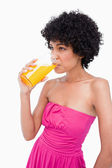 Relaxed teenager drinking a glass of orange juice — Stock Photo