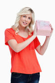 Young woman proudly holding her birthday gift — Stock Photo