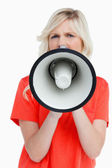 Woman looking upset while speaking into a megaphone — Stock Photo
