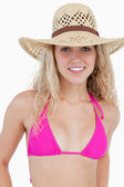 Smiling attractive teenager in beachwear standing upright — Stock Photo