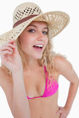Attractive blonde teenager holding her hat brim — Stock Photo