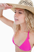 Attractive blonde woman trying to look far to the side — Stock Photo
