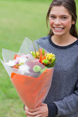 Young girl holding a bunch of flowers — Stock Photo