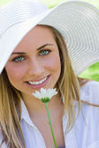 Young attractive blonde girl wearing a white hat while holding a — Stock Photo