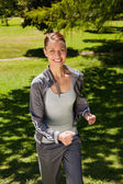Woman smiling while jogging — Stock Photo
