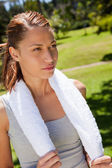 Woman holding a towel with both hands — Stock Photo