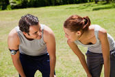 Man and a woman bending over while looking at each other — Stock Photo