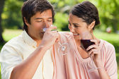 Man drinking wine while his friend looks at him — Stock Photo