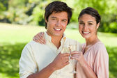 Two friends smiling while touching glasses of champagne — Stock Photo