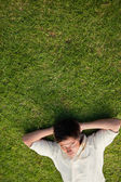 Elevated view of a man lying with his eyes closed and his head r — Stockfoto