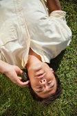 Man talks on the phone while lying on the grass — Stock Photo