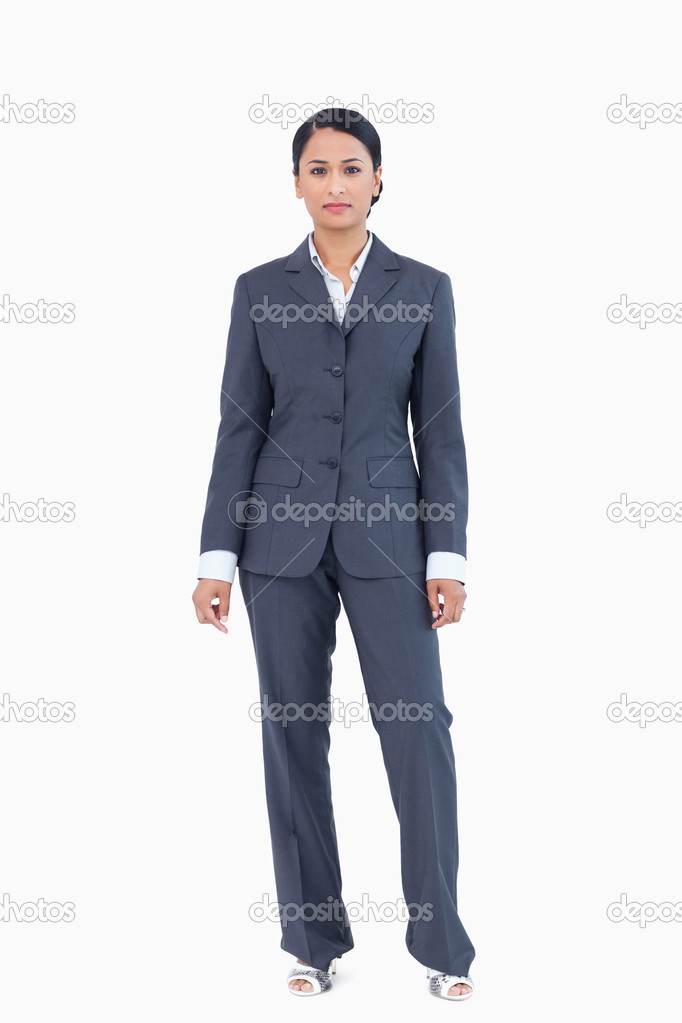 Businesswoman standing against a white background — Stock Photo #10321828