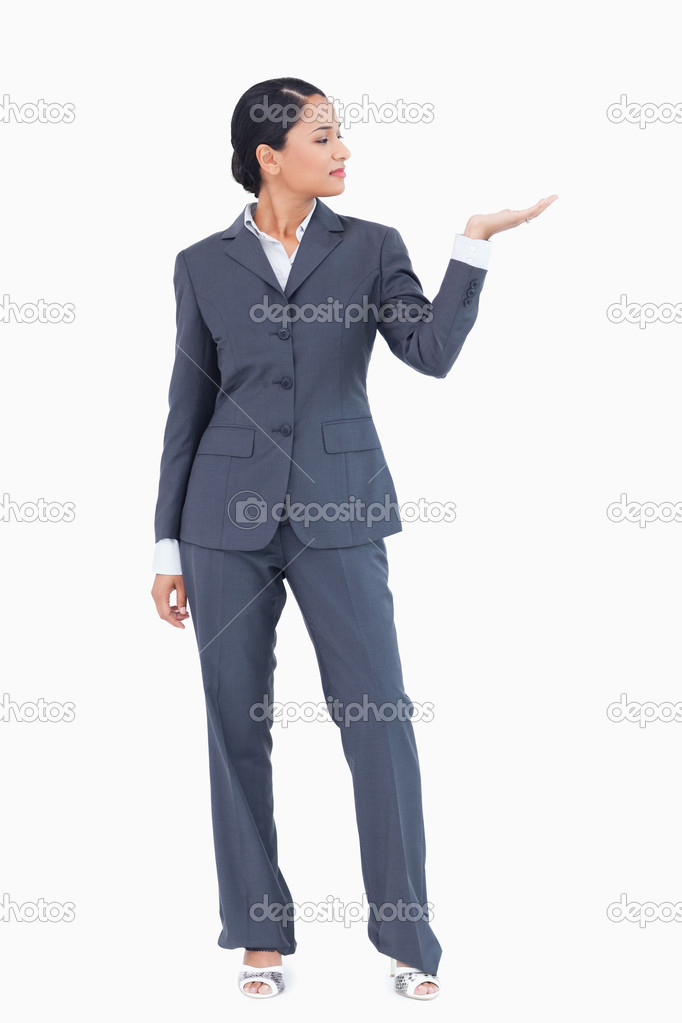 Businesswoman presenting with palm up against a white background — Stock Photo #10321859