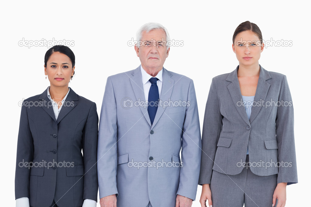 Three businesspeople standing against a white background — Stock Photo #10321907