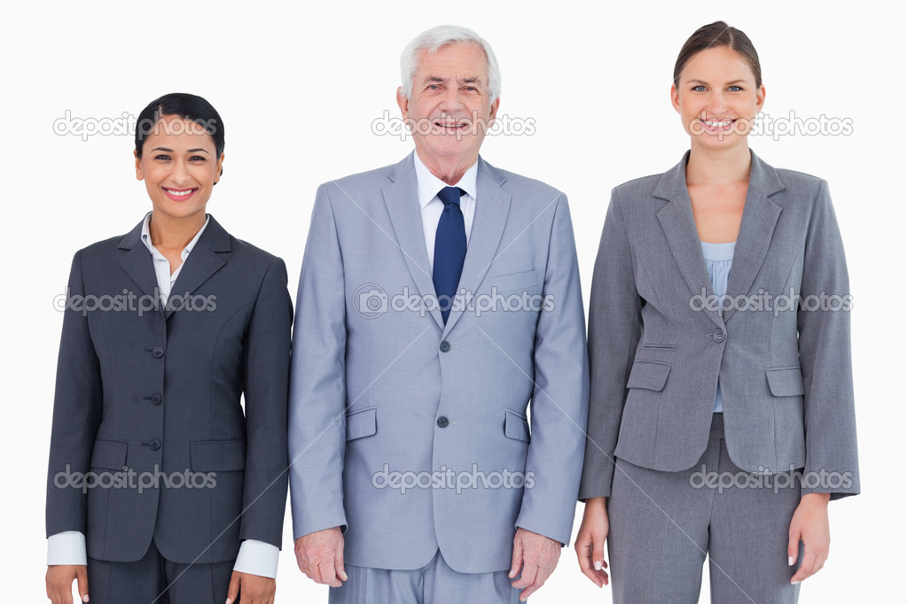 Three smiling businesspeople against a white background — Stock Photo #10321912