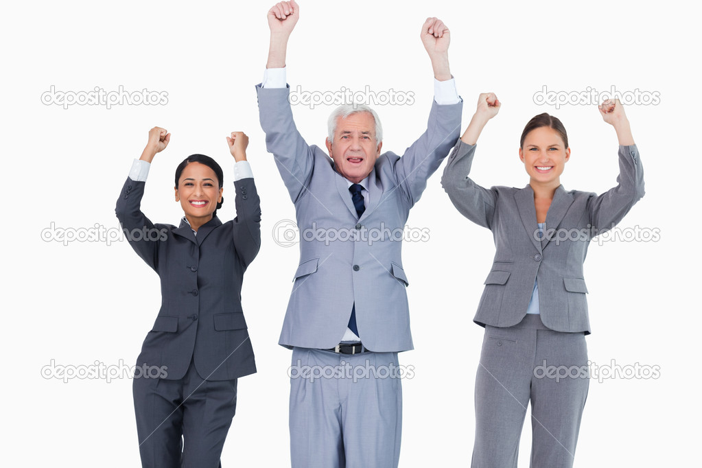 Three cheering businesspeople against a white background — Stock Photo #10321916