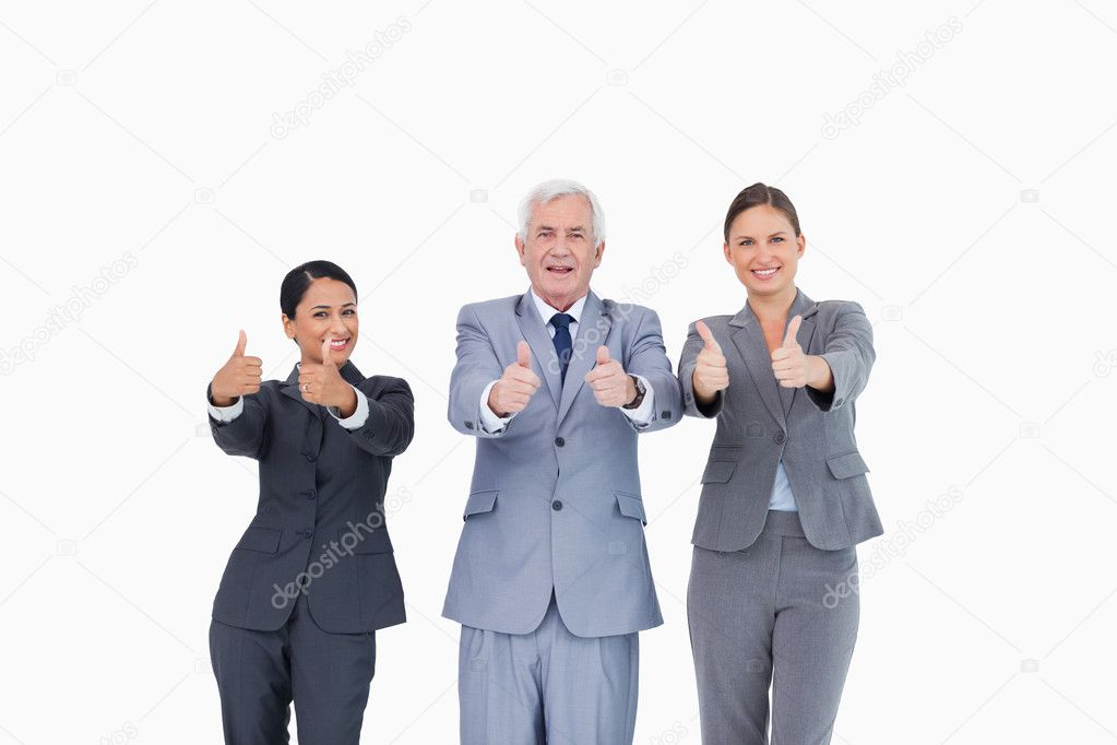 Three businesspeople giving thumbs up against a white background    #10321918