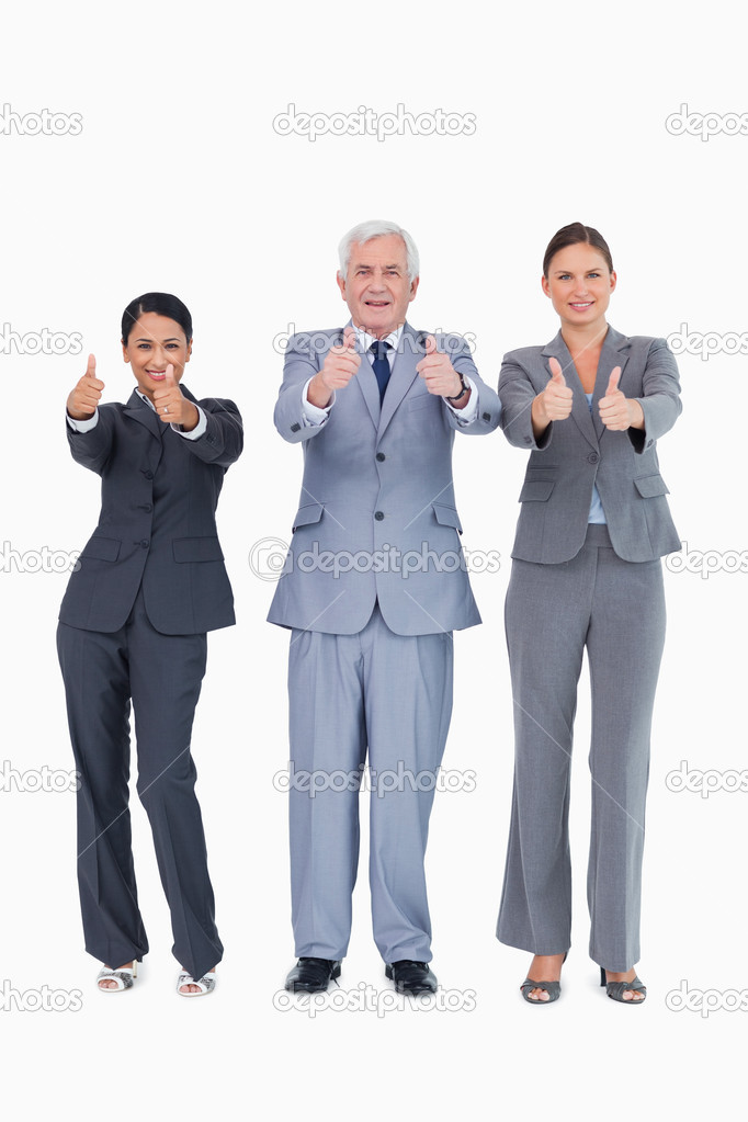 Three smiling businesspeople giving thumbs up against a white background — Lizenzfreies Foto #10321922