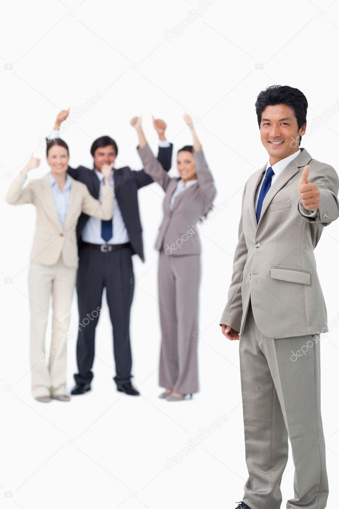 Salesman giving thumb up while getting celebrated against a white background — Stock Photo #10323112