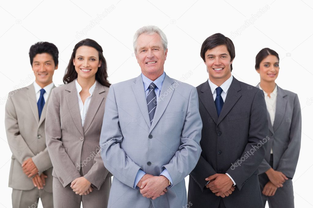 Smiling mature businessman standing with his team against a white background — Stock Photo #10323324