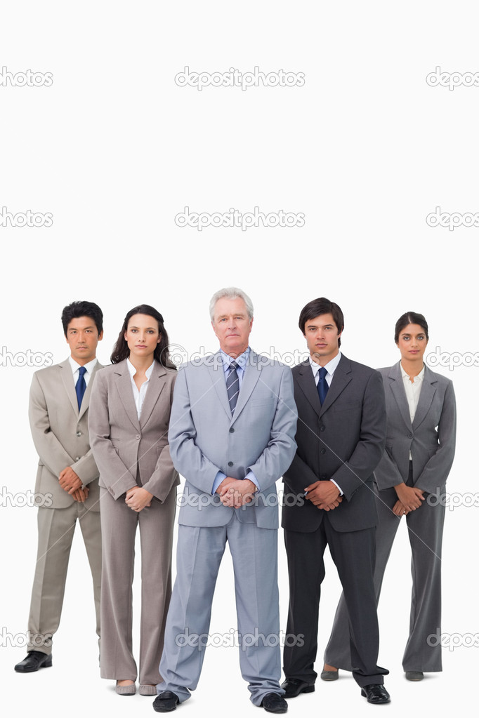 Mature salesman standing together with his team against a white background — Stock Photo #10323326