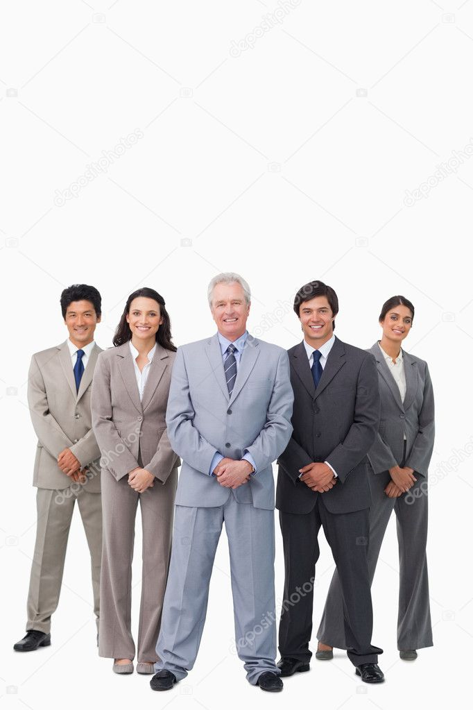 Smiling mature salesman standing together with his team against a white background — Stock Photo #10323328