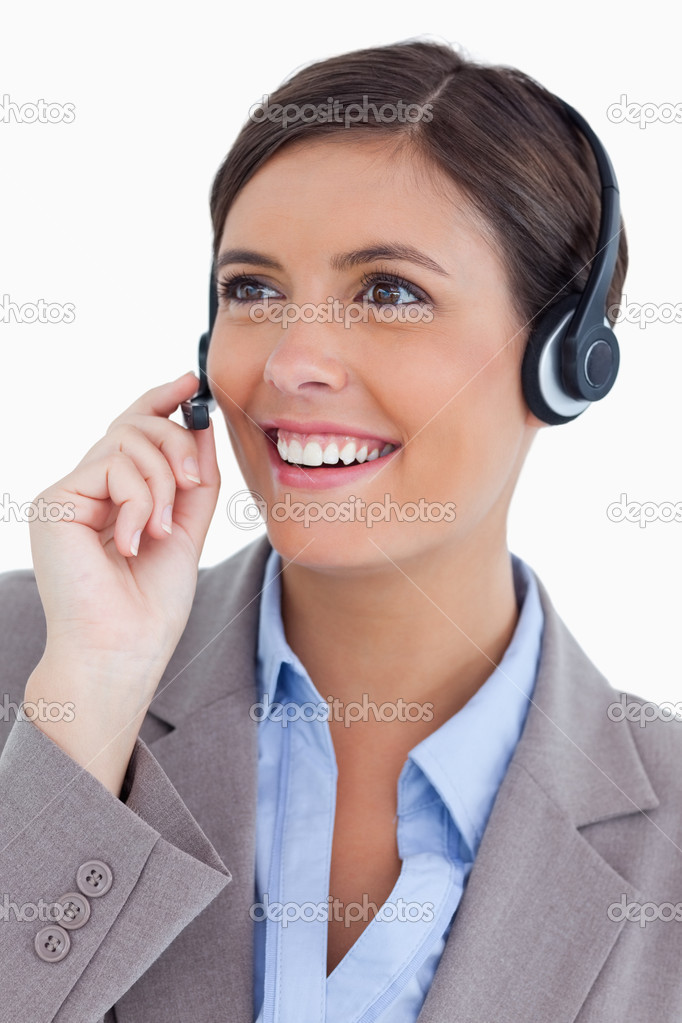 Close up of female call center agent with headset against a white background — Stock Photo #10326154
