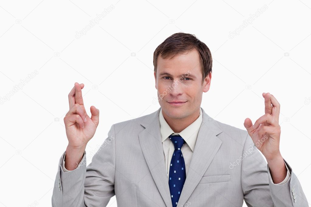 Close up of businessman with his fingers crossed against a white background — Stock Photo #10326691