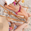 Stock Photo: Overhead view of young women sitting on the beach