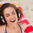 Young woman closing her eyes while listening to music — Stock Photo