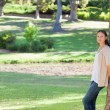 Woman leaning against a tree in the park — Stock Photo