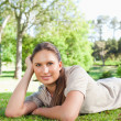 Stock Photo: Relaxed womlying on lawn