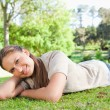 Woman relaxing on the grass - Foto Stock