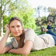 Stock Photo: Relaxed womlying on grass