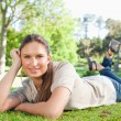 Relaxed woman lying in the park — Stock Photo #10330753