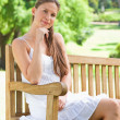 Woman on a bench in the park — Stock Photo