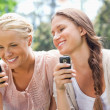 Smiling friend with cellphones — Stock Photo #10331138