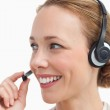 Close-up of a businesswoman talking with a headset — Stock Photo